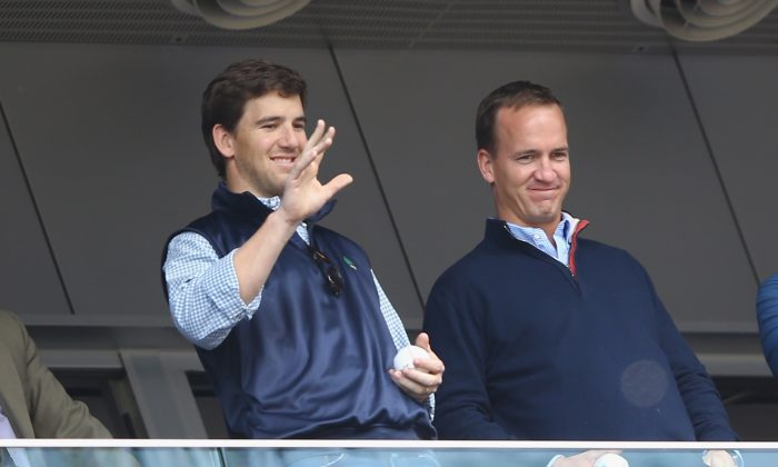 Eli Manning and his older brother Peyton Manning now have four Super Bowl rings between them. (Al Bello/Getty Images)