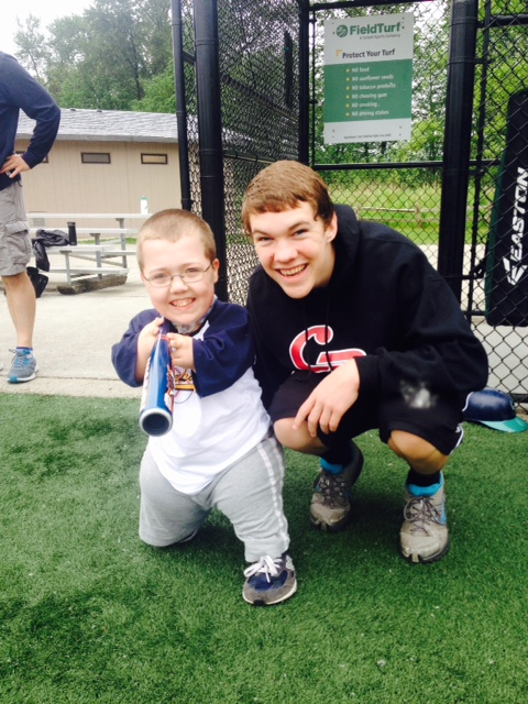 Nathan McBride (R) at Miracle League Baseball, a Random Acts of Kindness club event, with Jadon Fry (L). (Courtesy of Cedarcrest High School)