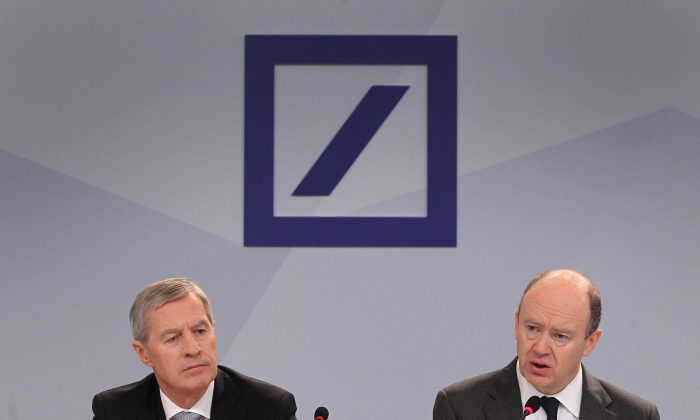 Jürgen Fitschen (L) and John Cryan, co-CEOs of the Deutsche Bank, at the company's annual press conference in Frankfurt, Germany, on Jan. 28, 2016. (Daniel Roland/AFP/Getty Images)