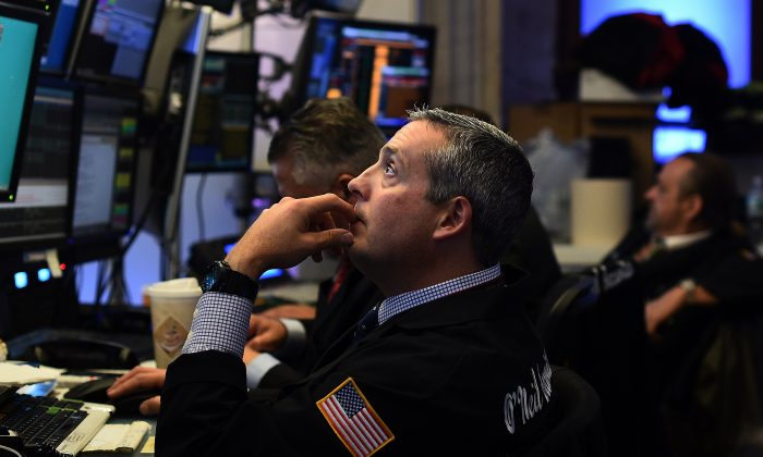 Traders work on the floor of the New York Stock Exchange (NYSE) in New York on Oct. 17, 2014. (Jewel Samad/AFP/Getty Images)