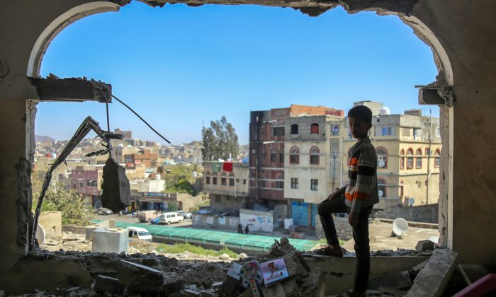 A Yemeni boy checks the damage following a mortar shell attack on the country's flashpoint southern city of Taez on Feb. 3, 2016. (Ahmad al-Basha/AFP/Getty Images)