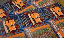 $200 Scratch Lotto Winnings Lead Woman to Help Homeless Man