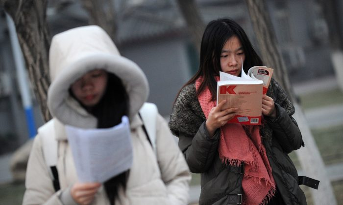 Students read before sitting the National Entrance Examination for Postgraduate (NEEP) at a university in Beijing on January 4, 2014. (WANG ZHAO/AFP/Getty Images)