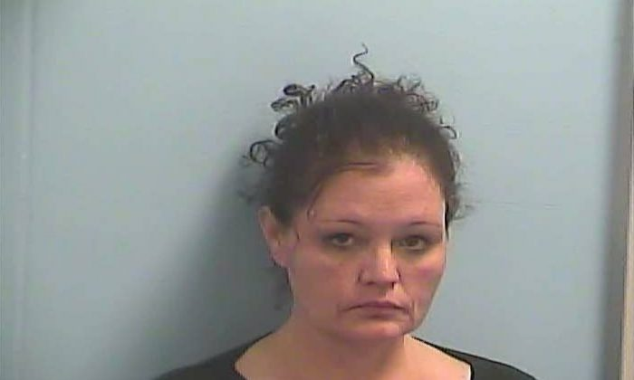 This photo provided by the Dawson County Sheriff's Office, shows Sonserea Dawn Evans, jailed Feb. 12 in Dawson County, Georgia, on charges of aggravated battery and drug possession. Dawson County sheriff's investigators say Evans used methamphetamine to spike the drink of a Waffle House co-worker, who was hospitalized in a comatose state and is still recovering nearly two months later. (Courtesy of the Dawson County Sheriff's Office via AP)