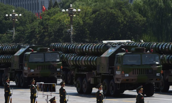 Chinese People's Liberation Army HQ-9 surface to air missile launchers are seen during a military parade at Tiananmen Square in Beijing on Sept. 3, 2015. (Greg Baker/AFP/Getty Images)