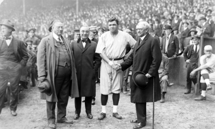 New York Yankees' owners, from left to right, Col. Tillinghast LHommedieu Huston and Jacob Ruppert appear with Babe Ruth and Gov. Nathan L. Miller of New York, Oct. 6, 1921.  (AP Photo)