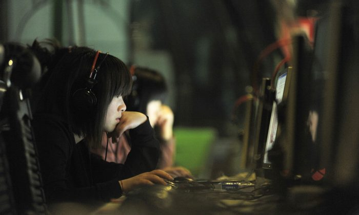 People use computers at an Internet cafe in Beijing. Cybercriminals in China's hacker underground are now going global on the DarkNet. (Gou Yige/AFP/Getty Images)