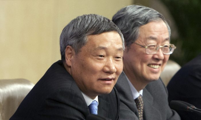 Then head of China Securities Regulatory Commission Xiao Gang (L) and Zhou Xiaochuan, governor of the People's Bank of China, at a press conference in Beijing, China, on March 11, 2014. Xiao who was appointed China's top securities regulator in March 2013 will step down following months of turmoil in the Chinese stock markets, the state-run news agency said Saturday, Feb. 20, 2016. (Chinatopix via AP)