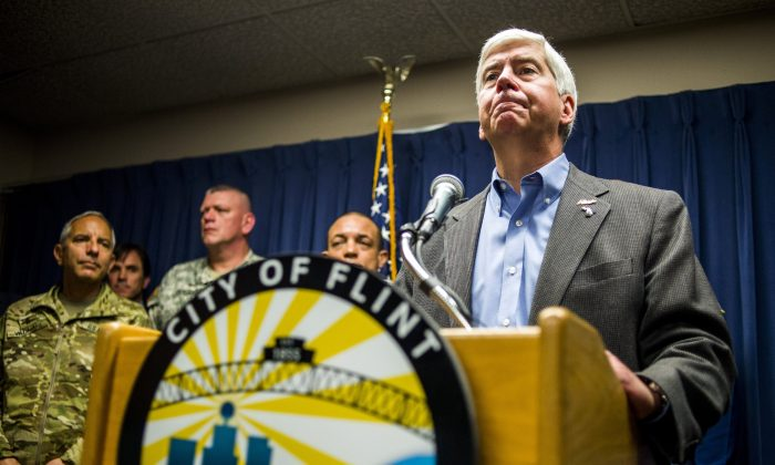 Gov. Rick Snyder speaks about the Flint water crisis during a press conference at City Hall in downtown Flint, Mich., on Jan. 27, 2016. (Jake May/The Flint Journal-MLive.com via AP)