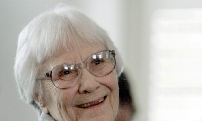 """In this Aug. 20, 2007, file photo, author Harper Lee smiles during a ceremony honoring the four new members of the Alabama Academy of Honor at the Capitol in Montgomery, Ala. Lee, elusive author of best-seller """"To Kill a Mockingbird,"""" died Friday, Feb. 19, 2016, according to her publisher, Harper Collins. She was 89. (AP Photo/Rob Carr, File)"""
