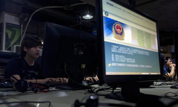 Acomputer displays message from the Chinese Great Firewall on the proper use of the Internet at an Internet cafe in Beijing. New web publishing news announced last week will bar foreign companies from publishing most forms of online content. (AP Photo/Ng Han Guan, File)