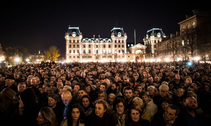 People gather outside of Notre Dame Cathedral in Paris, France, on Nov. 15, 2015, ahead of a ceremony to the victims of the Nov. 13 terrorist attacks. 129 people were killed and hundreds more injured in Paris following a series of terrorist acts in the French capital. (David Ramos/Getty Images)