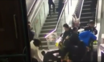 Crowded Escalator in China Suddenly Changes Direction Causing Pile-Up