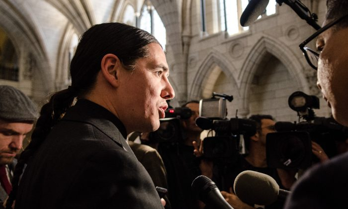 Liberal MP Robert-Falcon Ouellette speak to reporters on Parliament Hill outside the room where the finance committee had just finished questioning Finance Minister Bill Morneau on Feb 23, 2015. (Matthew Little/Epoch Times)