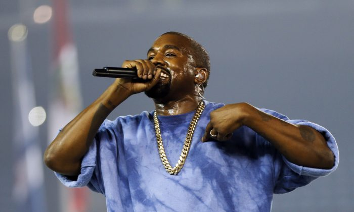 Kanye West performs during the closing ceremony of the Pan Am Games in Toronto on July 26, 2015. (AP Photo/Julio Cortez)