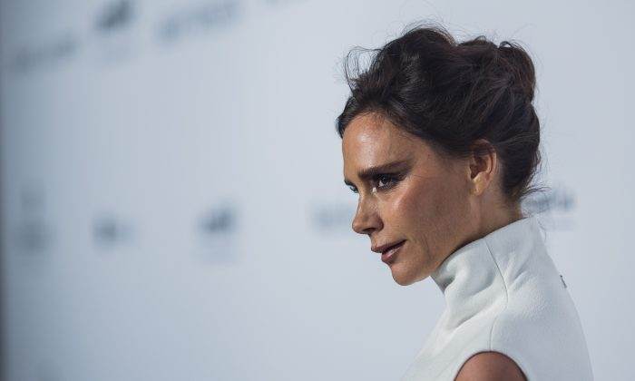 Fashion Designer and Singer Victoria Beckham arrives on the red carpet during the 2015 amfAR Hong Kong gala at Shaw Studios on March 14, 2015 in Hong Kong. (Jerome Favre/Getty Images)