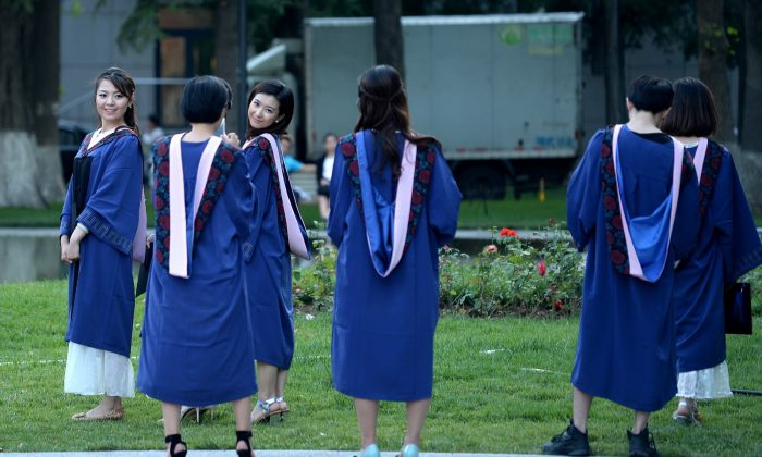 A group of students pose for photographs at a university in Beijing on June 8, 2015. (WANG ZHAO/AFP/Getty Images)