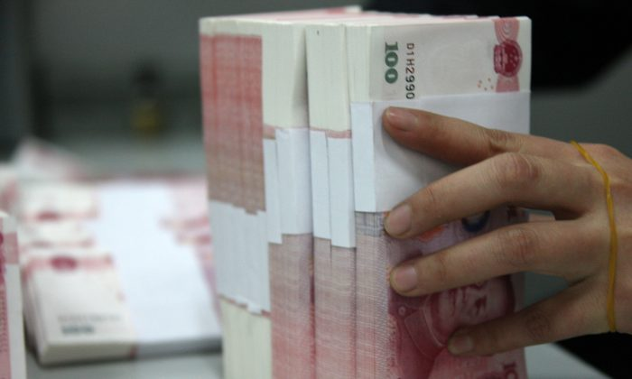 Chinese yuan notes at a branch of the Industrial and Commercial Bank of China (ICBC), on March 14, 2011 in Huaibei, China. The Chinese government is now spending up to 15 percent of GDP on fiscal stimulus. (ChinaFotoPress/Getty Images)
