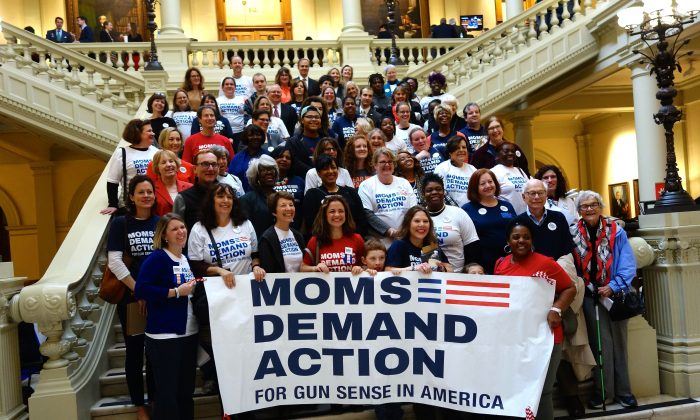 """Moms Demand Action, who advocate for what they call """"gun sense,"""" pose on the steps of the Georgia Capitol in Atlanta on Feb. 24, 2016. Advocates, lobbyists, and students packed the building to talk to their representatives during the legislative session. (Mary Silver/Epoch Times)"""