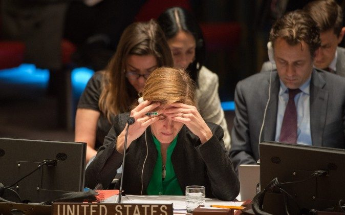 United States Ambassador to the United Nations Samantha Power reads before a vote to support a United Nations resolution endorsing a cease-fire in Syria, Friday, Feb. 26, 2016 at United Nations headquarters. (AP Photo/Bryan R. Smith)