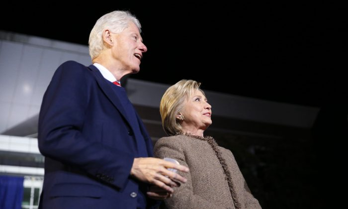 "Democratic presidential candidate Hillary Clinton and her husband, former President Bill Clinton, arrive onstage to speak at a ""Get Out The Vote Rally"" in Columbia, S.C., on Feb. 26, 2016. (AP Photo/Gerald Herbert)"