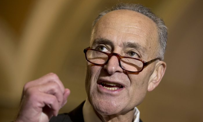 """Sen. Charles Schumer (D-N.Y.) talks to media on Capitol Hill in Washington, D.C., on Oct. 20, 2015. Schumer wants to require the Federal Aviation Administration to establish seat-size standards for commercial airlines, which he says now force passengers to sit on planes """"like sardines."""" (AP Photo/Carolyn Kaster)"""