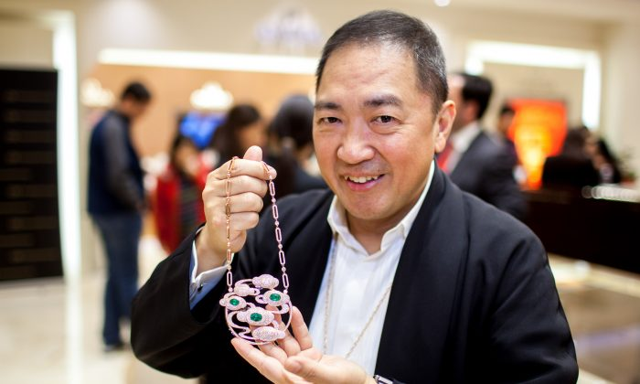 Qeelin co-founder Dennis Chan showcases one of his top pieces during the unveiling of Qeelin Collections and Chinese New Year Festivities at CH Premier Jewelers in the Westfield Shopping Center in Santa Clara, Calif., on Feb. 20. (Christian Lambert for Epoch Times)