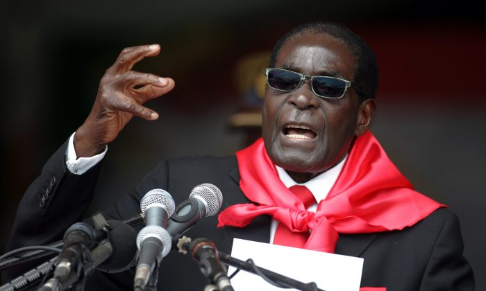 Zimbabwe's President Robert Mugabe talks during celebrations marking his 90th birthday in Marondera, on February 23, 2014. (JEKESAI NJIKIZANA/AFP/Getty Images)