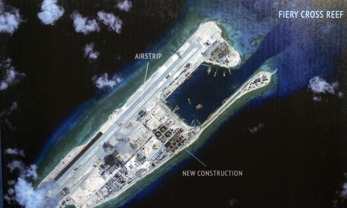 """An island that China is building on the Fiery Cross Reef in the South China Sea. The Chinese regime is now deploying """"anti-access"""" weapons in the region. (Cliff Owen/AP)"""