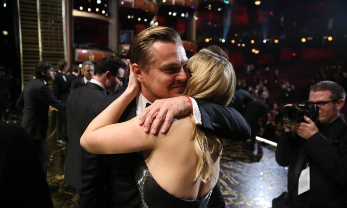 """Leonardo DiCaprio, winner of the award for best actor in a leading role for """"The Revenant"""" embraces Kate Winslet backstage at the Oscars on Sunday, Feb. 28, 2016, at the Dolby Theatre in Los Angeles. (Matt Sayles/Invision/AP)"""
