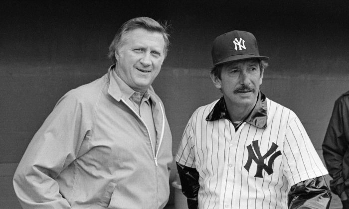 In this March 1, 1983, file photo, New York Yankees owner George Steinbrenner, left, and manager Billy Martin, get together outside the dugout at baseball spring training in Fort Lauderdale, Fla.  Steinbrenner owned the Yankees from 1973 until his death in July, and the team won seven World Series championships, 11 AL pennants and 16 AL East titles during his turbulent and blustery reign. Martin had five stints as Yankees manager under Steinbrenner, who fired him four times and let him resign once. (AP Photo/Ray Howard, File)
