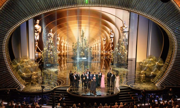Members of the cast and producers of Spotlight accept the award for Best Picture at the 88th Oscars on February 28, 2016 in Hollywood, California. (MARK RALSTON/AFP/Getty Images)