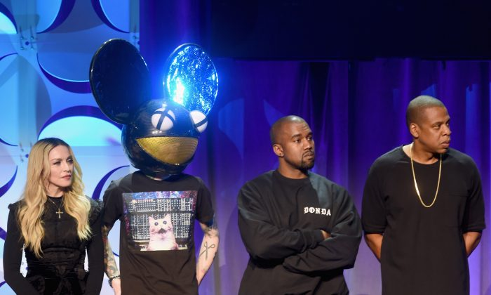 (L-R) Madonna, Deadmau5, Kanye West, and JAY Z onstage at the Tidal launch event #TIDALforALL at Skylight at Moynihan Station on March 30, 2015 in New York City. (Photo by Jamie McCarthy/Getty Images for Roc Nation)