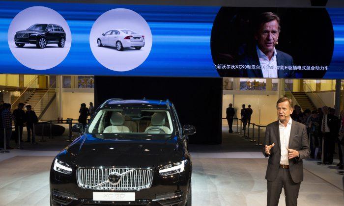 Hakan Samuelsson, CEO of Volvo Car Group, presents the XC90 SUV at the Shanghai auto show on April 20, 2015. (AP Photo/Ng Han Guan)