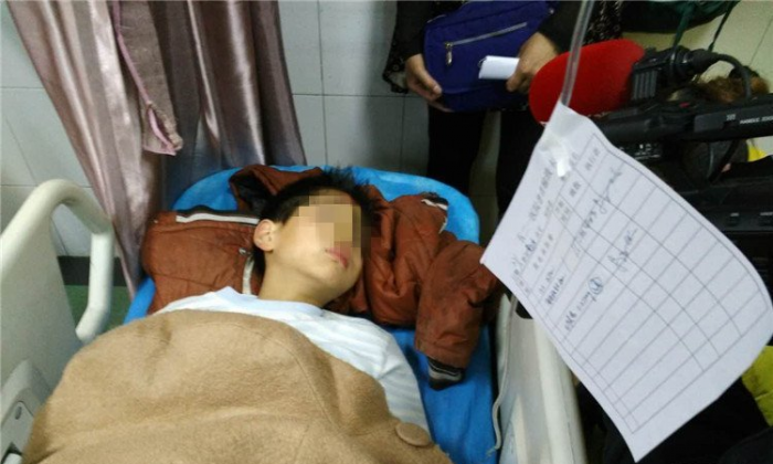 Xiao Xu in the hospital (via Chinese Business Review)