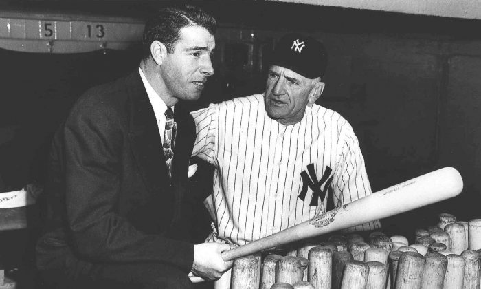 New York Yankees center fielder Joe DiMaggio speaks with manager Casey Stengel in the dugout in this undated photo. (AP Photo)