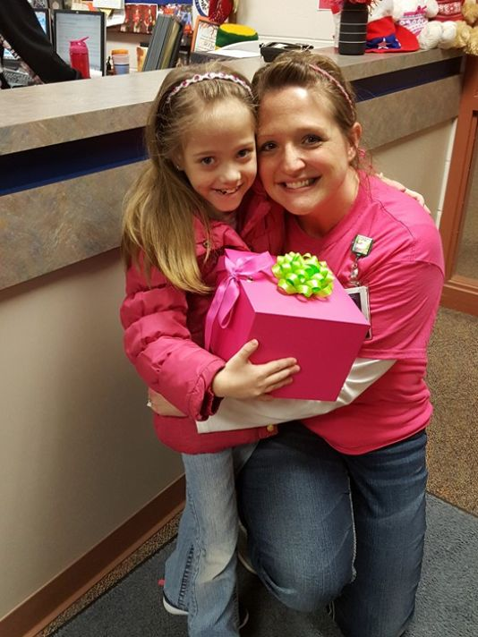 (Photo: Courtesy of Chris Burleton)  Natasha Fuller, 8, embraces Oakfield Elementary School teacher Jodi Schmidt, who is set to donate her kidney to the little girl.