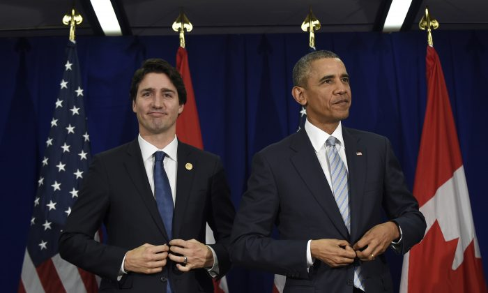 U.S. President Barack Obama, right, and Canada's Prime Minister Justin Trudeau stand up following their bilateral meeting at the Asia-Pacific Economic Cooperation summit in Manila, Philippines, Thursday, Nov. 19, 2015. (AP Photo/Susan Walsh)