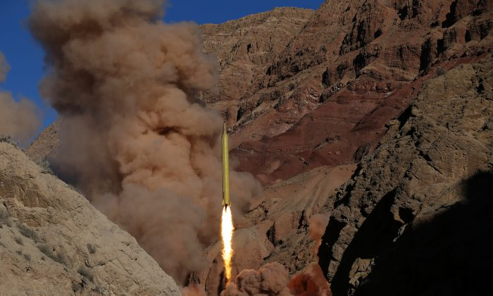 A Qadr H long-range ballistic surface-to-surface missile is fired by Iran's powerful Revolutionary Guard, during a maneuver, in an undisclosed location in Iran on March 9, 2016. (Omid Vahabzadeh/Fars News Agency via AP)