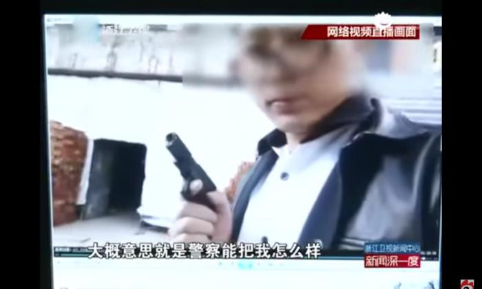 Xu Fei in his ill-concceived stunt. (via Zhejiang Weishi)