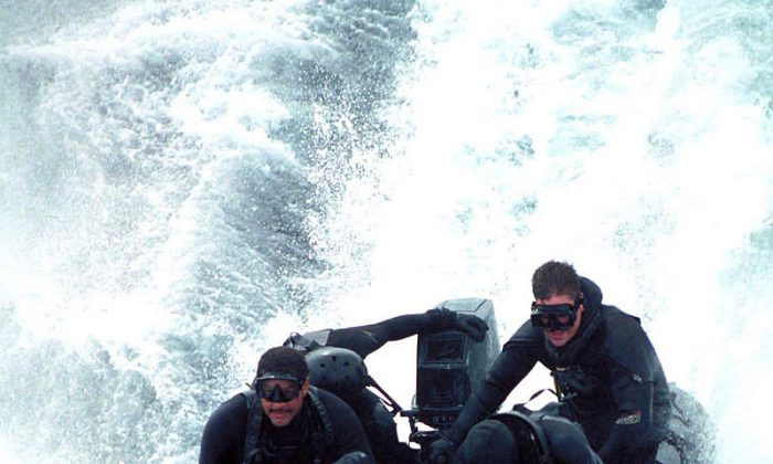 Members of the Sea Air Land Team Five (SEAL5), from Golf Platoon, conduct an exercise in a Combat Rubber Raiding Craft (CRRC) or Ridged Boat Inflatable Hull (RBIH). (Courtesy of U.S. Navy)