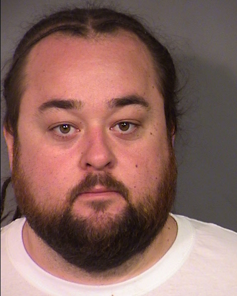In this handout photo provided by the Las Vegas Metropolitan Police Department, Austin 'Chumlee' Russell is seen in a booking photo after his arrest for possession of a firearm and numerous narcotics including methamphetamine and marijuana during a sexual assault investigation raid at his home on March 9, 2016 in Las Vegas, Nevada.  Chumlee has not been charged in connection to the sexual assault investigation. (Las Vegas Metropolitan Police Department via Getty Images)