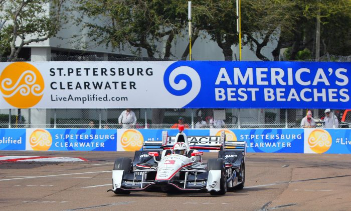 Three-time IndyCar St. Pete GP winner Helio Castroneves rounds Turn 4 during morning practice. (Chris Jasurek/Epoch Times)