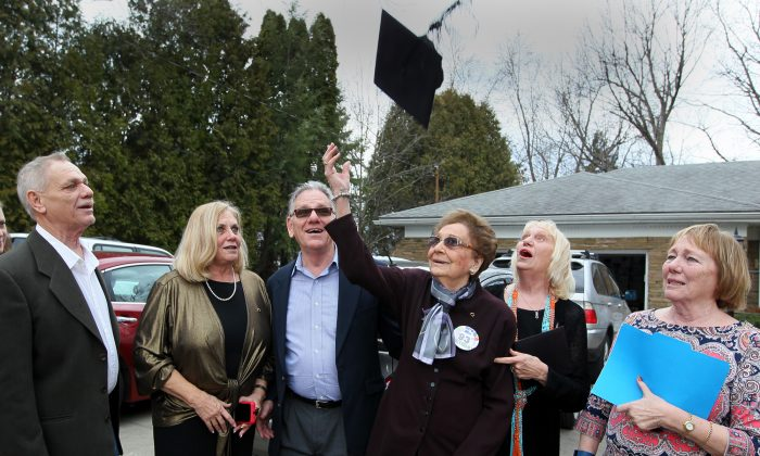 Dorothy L. Liggett  tosses her graduation cap into the air after receiving her belated high school diploma on her 93rd birthday on Wednesday, March 9, 2016, in Fairlawn, Ohio. She was joined by her children John Huston (left), Carol Weiner, Donald Huston, Diane Bailey and Jan Larkin for the celebration.  Liggett was a few weeks from graduation from Akron's North High School in 1942 when officials discovered she was married. Liggett and her late husband, John Huston, ran away to Kentucky to get married after her husband was called into the U.S. Army Air Corps during World War II. (Michael Chritton/Akron Beacon Journal via AP)  MANDATORY CREDIT