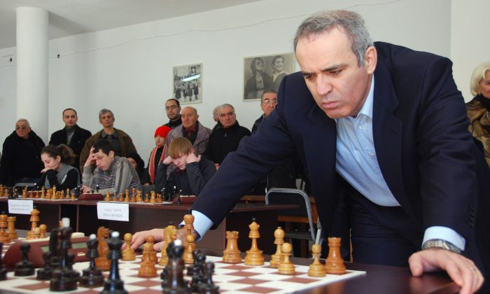 Chess grandmaster, former World Chess Champion and one of the leaders of Russian political opposition Garry Kasparov plays simultaneous chess games in Tbilisi on February 16, 2011, during his visit to Georgia.  Kasparov has become one of the Kremlin's most outspoken critics -- a stance that is admired in pro-Western Georgia, which fought a war with Russia in 2008.   AFP PHOTO/ NINA SHLAMOVA (Photo credit should read NINA SHLAMOVA/AFP/Getty Images)