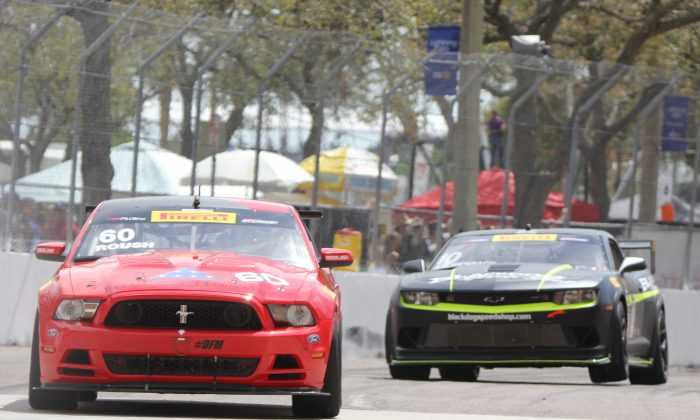 Jack Roush Jr. in the #60 Roush Mustang leads Lawson Aschenbach, in the #10 Black Dog Speed Shop Camaro Z28 early in the Pirelli World Challenge GTS race. (Chris Jasurek/Epoch Times)