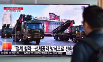 North Korea Releases Surveillance Video Showing American Removing Banner