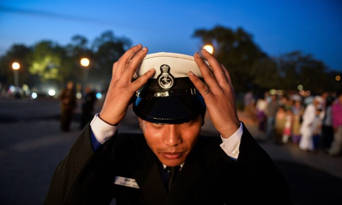 A member of the Indian Navy band adjusts his cap in New Delhi on March 4. Japan and Vietnam are asking India to help counter Chinese aggression in the South China Sea. (Chandan Khanna/AFP/Getty Images)