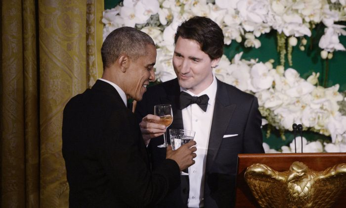 President Barack Obama and Canadian Prime Minister Justin Trudeau exchange toasts during a State Dinner at the White House in Washington, D.C., on March 10, 2016. (Olivier Douliery/Getty Images)