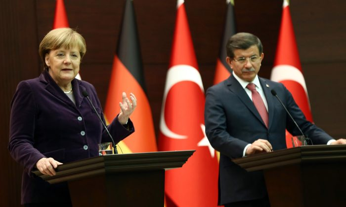 German Chancellor Angela Merkel (L) and Turkish Prime Minister Ahmet Davutoglu at a joint press conference in Ankara on Feb. 8, 2016. (Adem Altan/AFP/Getty Images)